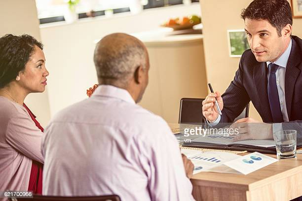 Financial advisor talking to a couple of African descent