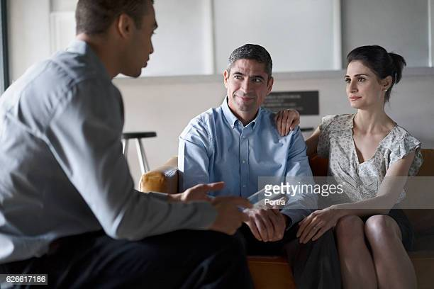 Financial advisor talking to couple in office