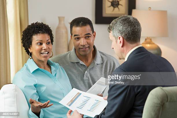 Financial advisor talking with clients