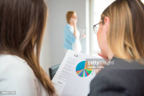 Financial advisor with a client looking at report