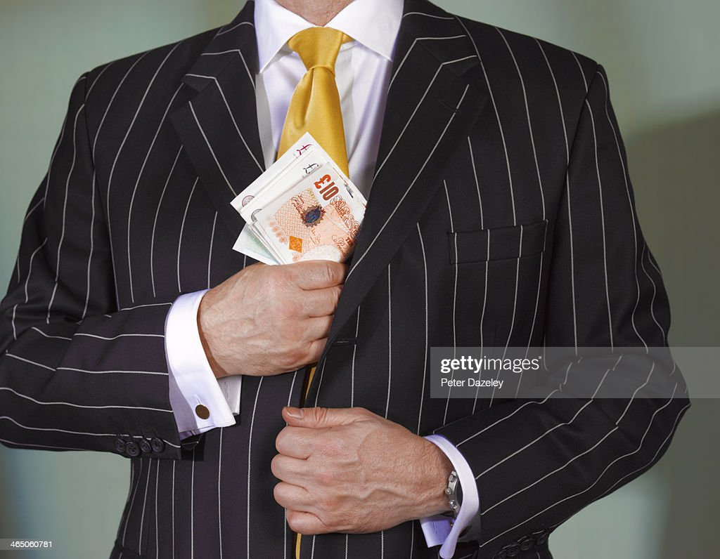 Financial advisor with british currency : Stock Photo