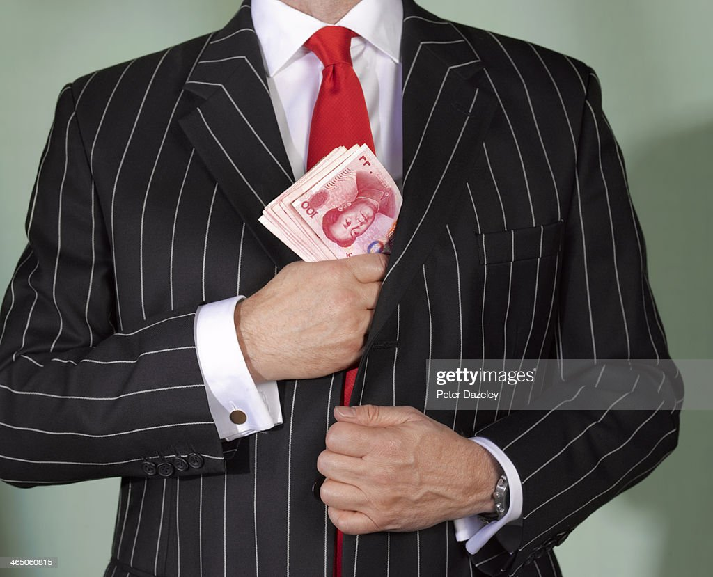 Financial advisor with chinese currency : Stock Photo