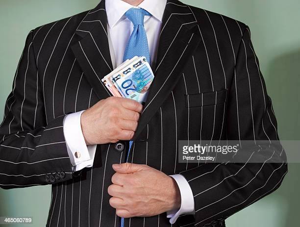 financial advisor with euro currency - falsenews stock pictures, royalty-free photos & images