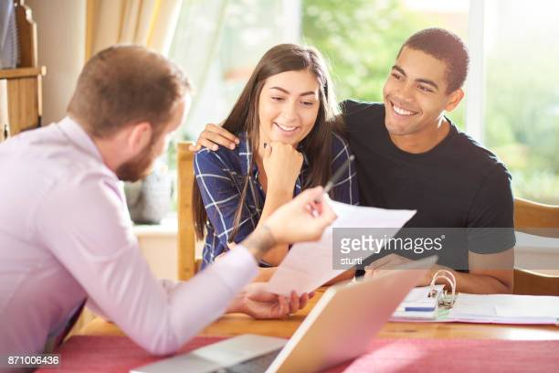 financial advisor with young couple