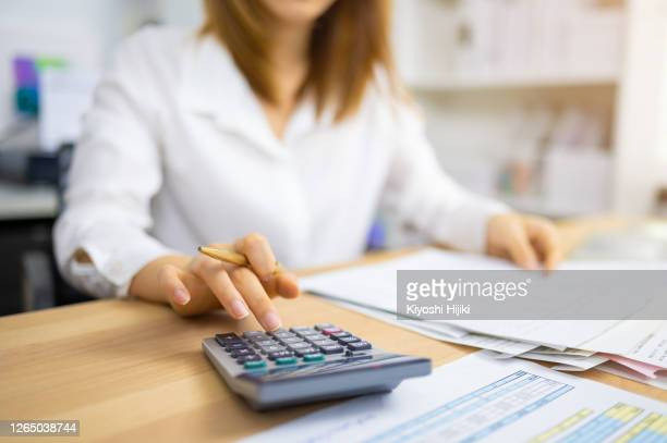 financial auditor analyzing company financial report concept of accounting, accountancy and tax form - government stock pictures, royalty-free photos & images