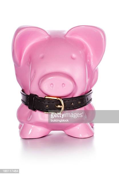financial belt tightening piggy bank - tighten stock pictures, royalty-free photos & images