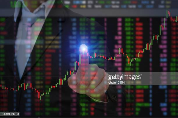 Financial brokers and business man touch stock market analysis screen for make a profit. Business and financial concept.