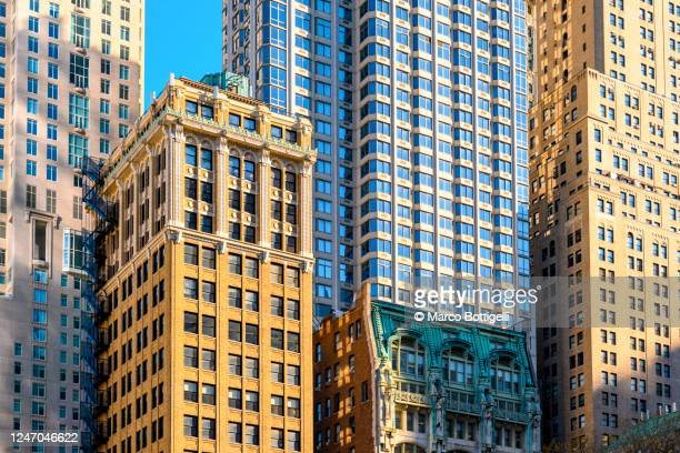 financial buildings, new york city - american culture stock pictures, royalty-free photos & images