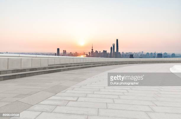 financial center shanghai - asphalt paving stock photos and pictures