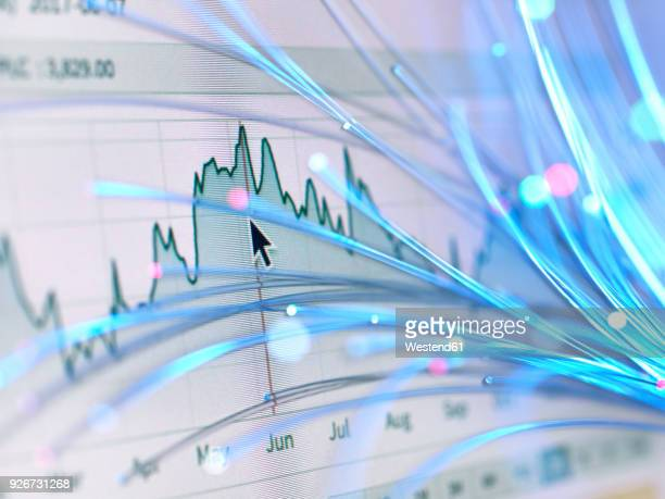 financial charts and fibre optics symbolizing innovative stock market developments - the image bank stock pictures, royalty-free photos & images