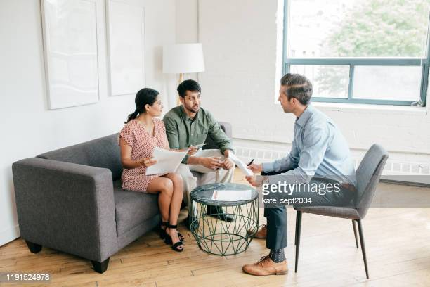 financial consultation with financial advisor - customer stock pictures, royalty-free photos & images