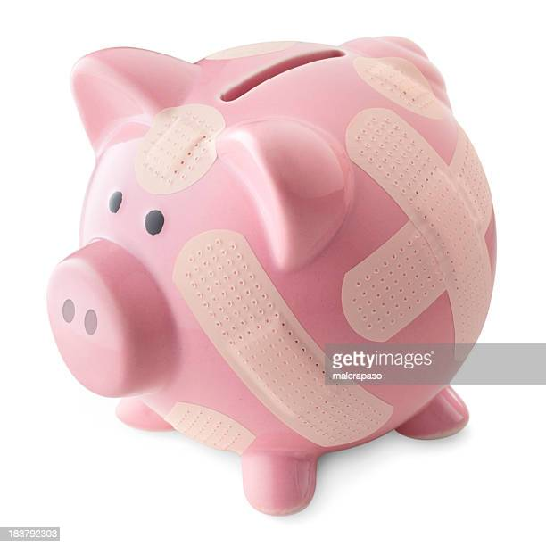 Financial crisis. Piggy bank with band aids.