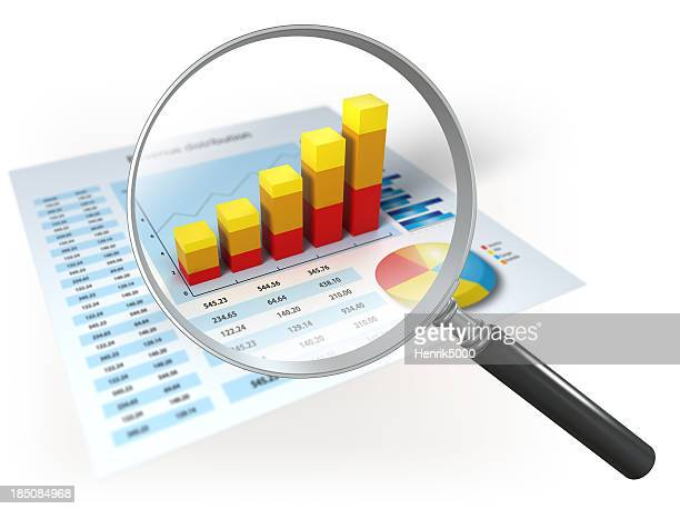 financial data and magnifying glass, isolated on white - magnification stock pictures, royalty-free photos & images