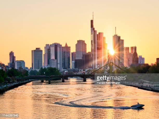 financial district at sunset with main river in the foreground, frankfurt, hesse, germany - frankfurt main bildbanksfoton och bilder