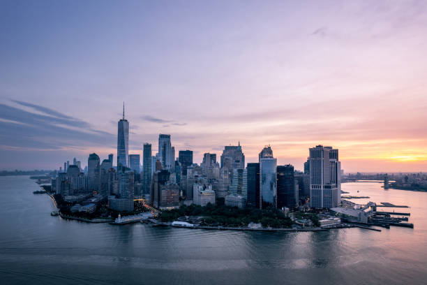 Financial district cityscape with one world trade center at sunset, Manhattan, New York, USA