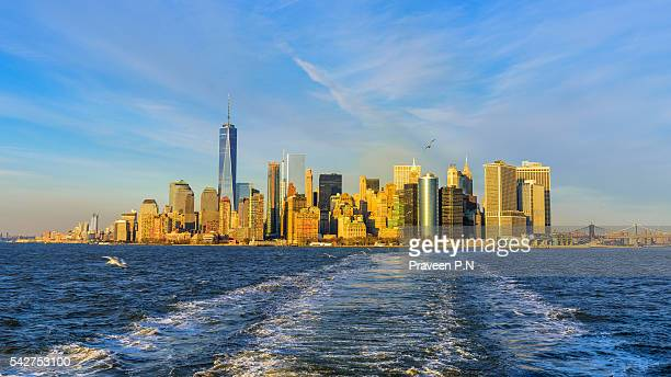 financial district during sunset - staten island ferry stock pictures, royalty-free photos & images