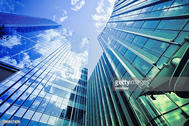 financial district glass buildings, city of london - canary wharf stock photos and pictures