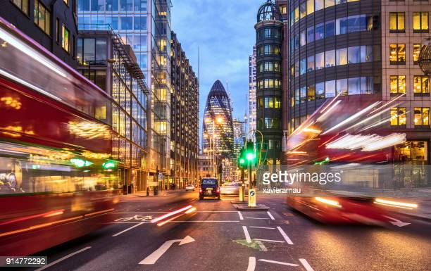 financial district in london at dusk - britain stock pictures, royalty-free photos & images