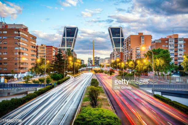 financial district with kio towers in paseo de la castellana avenue at dusk, madrid. spain - madrid stock pictures, royalty-free photos & images