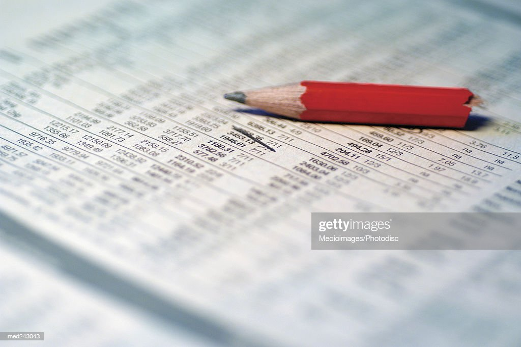 Financial document red pencil on it, extreme close-up : Stock Photo