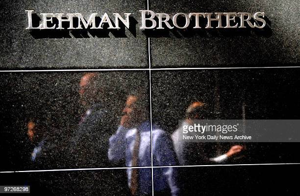 Financial giant Lehman Brothers - yet another leading financial institution - to go bust. Former employees leave the headquarters at 745 7th Avenue