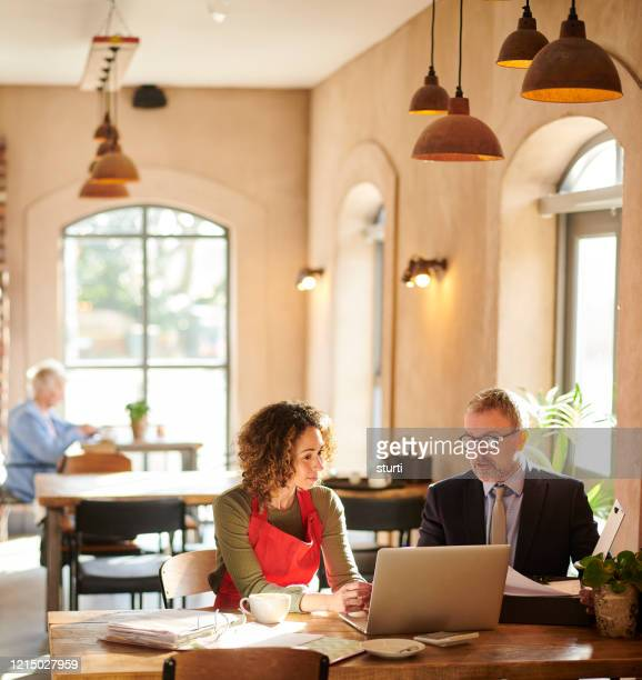 financial help for cafe owner - restaurant stock pictures, royalty-free photos & images