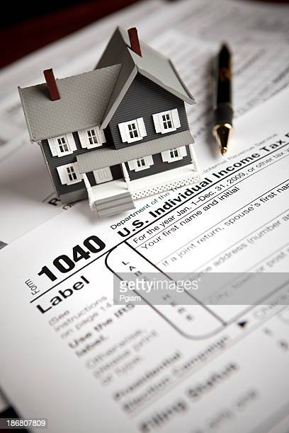 financial irs tax forms - 1040 tax form stock photos and pictures