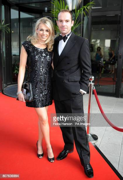 Financial journalist and Moneysavingexpert.com site proprietor, Martin Lewis arrives with wife Lara for the Spirit of Fire Awards, which honour the...