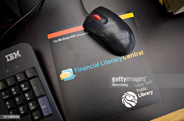 A Financial Literacy Central logo appears on a mouse pad during the opening of 'Financial Literacy Central' at the New York Public Library's Science...