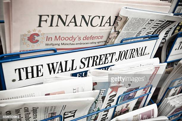 financial newspapers on a newsstand - editorial stock pictures, royalty-free photos & images