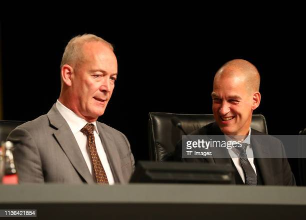 Financial operations guide Thomas Tress speaks with director Carsten Cramer during the Borussia Dortmund General Assembly on November 25 2018 in...