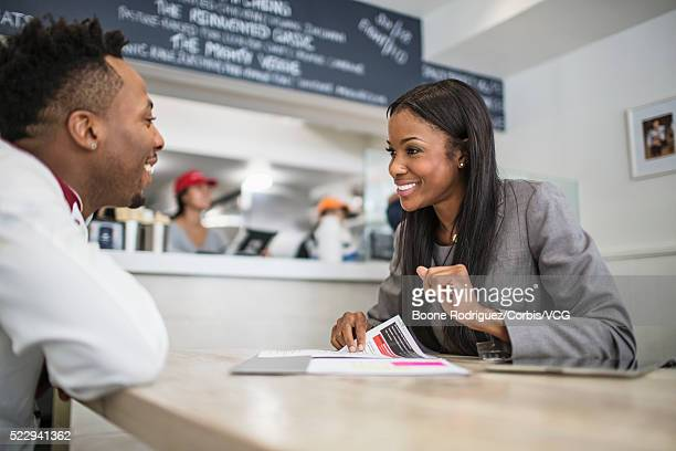 Financial planner talking with small business owner