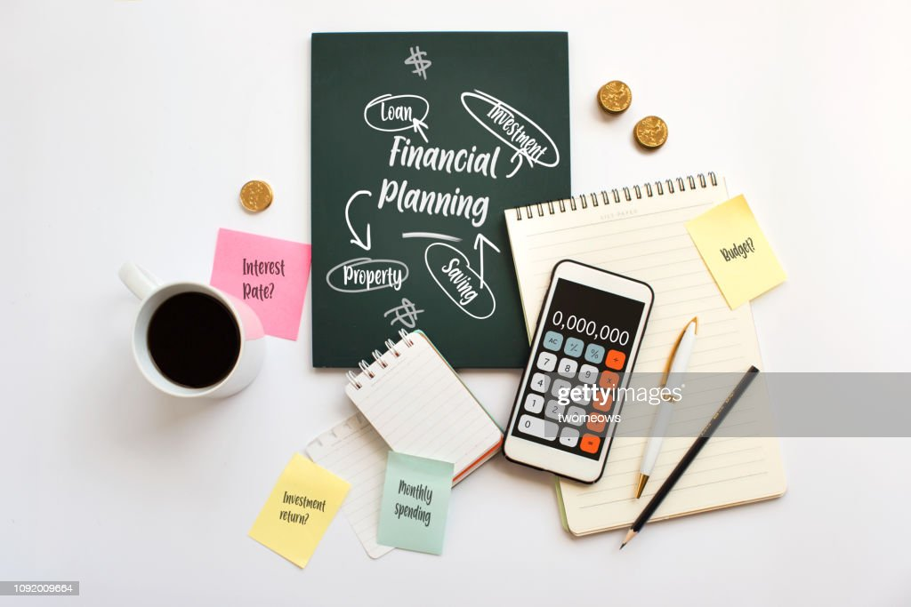 Financial planning brainstorming messy table top. : Stock Photo