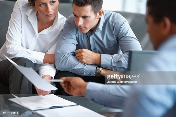 financial planning - couple getting consulted - stock trader stock pictures, royalty-free photos & images