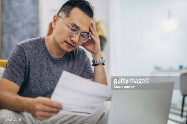 financial problems - burden stock pictures, royalty-free photos & images