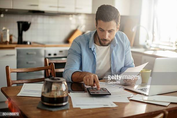 financial problems - calculator stock photos and pictures