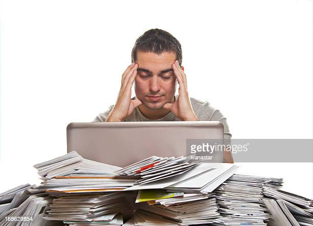 Financial Problems, Young Man with Paperwork Overload and Unpaid Bills