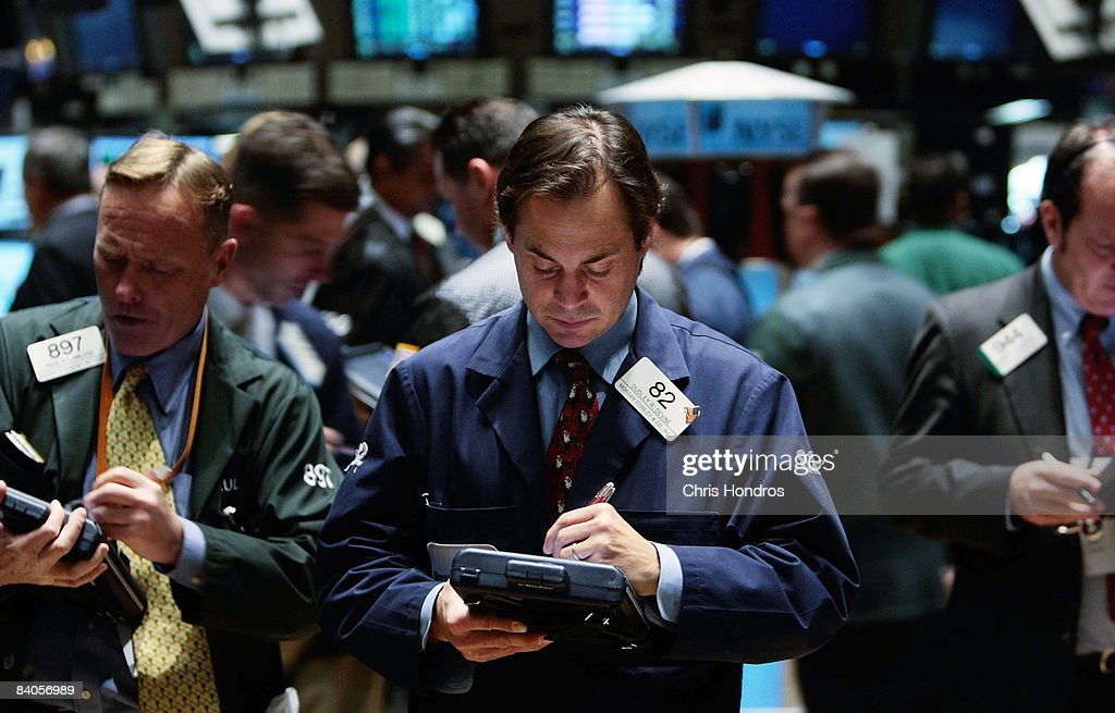 A financial professional works with a hand-held computer on the floor of the New York Stock Exchange at the end of the trading day December 16, 2008 in New York City. The Federal Reserve slashed the federal funds rate, the interest banks charge each other, to a record low of zero to one quarter percent, sending stocks higher in mid-afternoon trading.