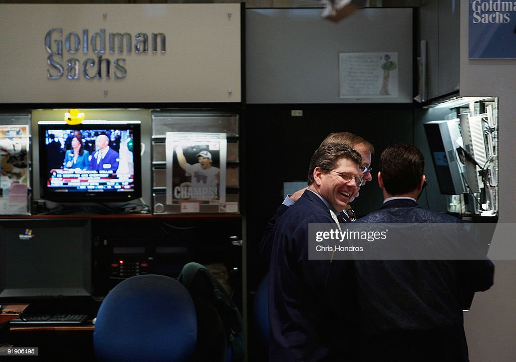 Financial professionals laugh in the Goldman Sachs booth on the floor of the New York Stock Exchange during afternoon trading December 16, 2008 in New York City. Goldman Sachs posted a quarterly profit of 3.19 billion October 15, 2009.