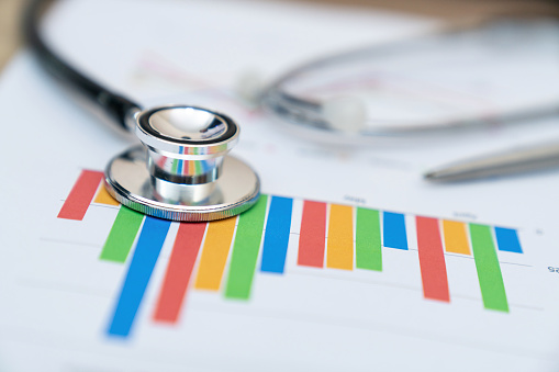 financial report chart and calculator Medical Report and stethoscope - gettyimageskorea