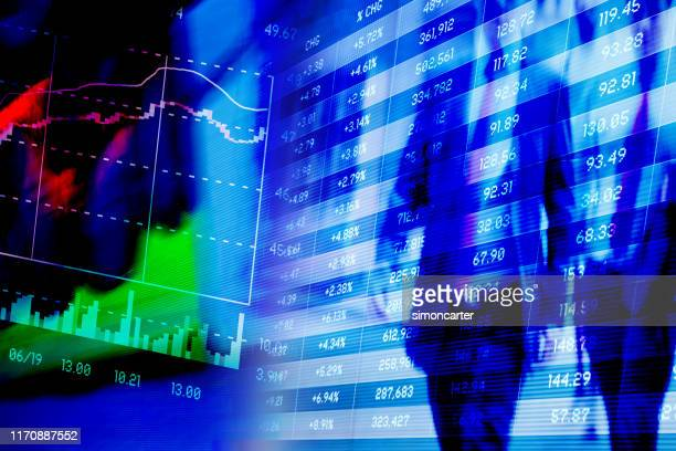 financial screens with blurred businessmen - speed stock pictures, royalty-free photos & images