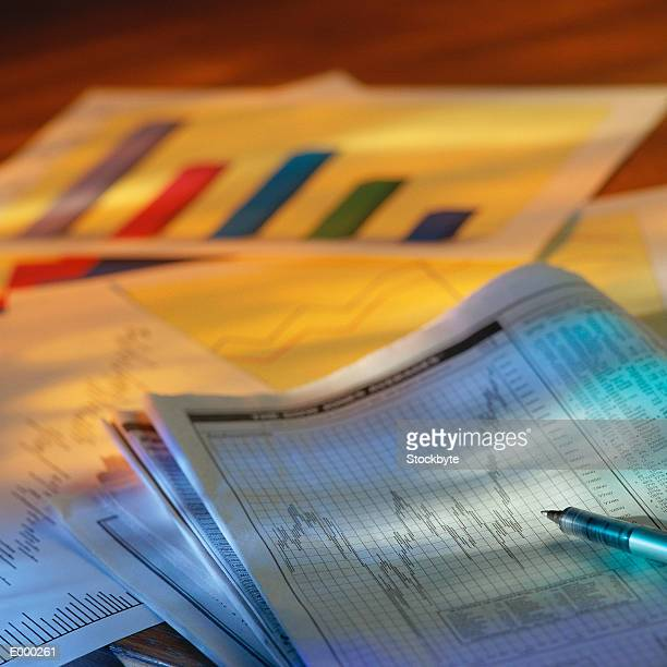 Financial section of newspaper and charts