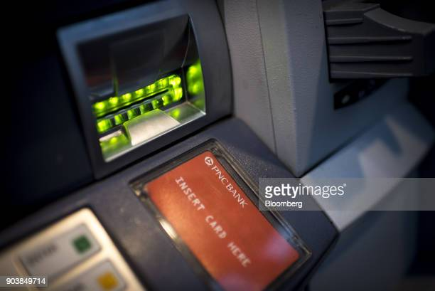 PNC Financial Services Group Inc signage is seen on an automatic teller machine in downtown Chicago Illinois US on Tuesday Jan 9 2018 PNC Financial...