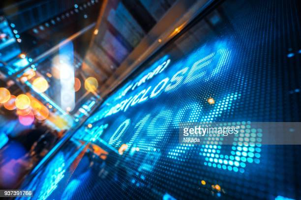 financial stock market numbers and city light reflection - hang seng index stock pictures, royalty-free photos & images