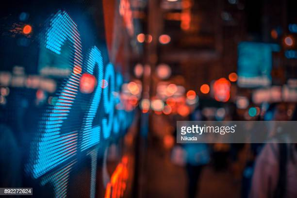 financial stock market numbers and city lights - finance and economy stock pictures, royalty-free photos & images