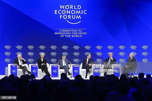 Financial Times editor Martin Wolf IMF Managing Director Christine Lagarde listen to Governor of the Bank of Japan Haruhiko Kuroda British Chancellor...