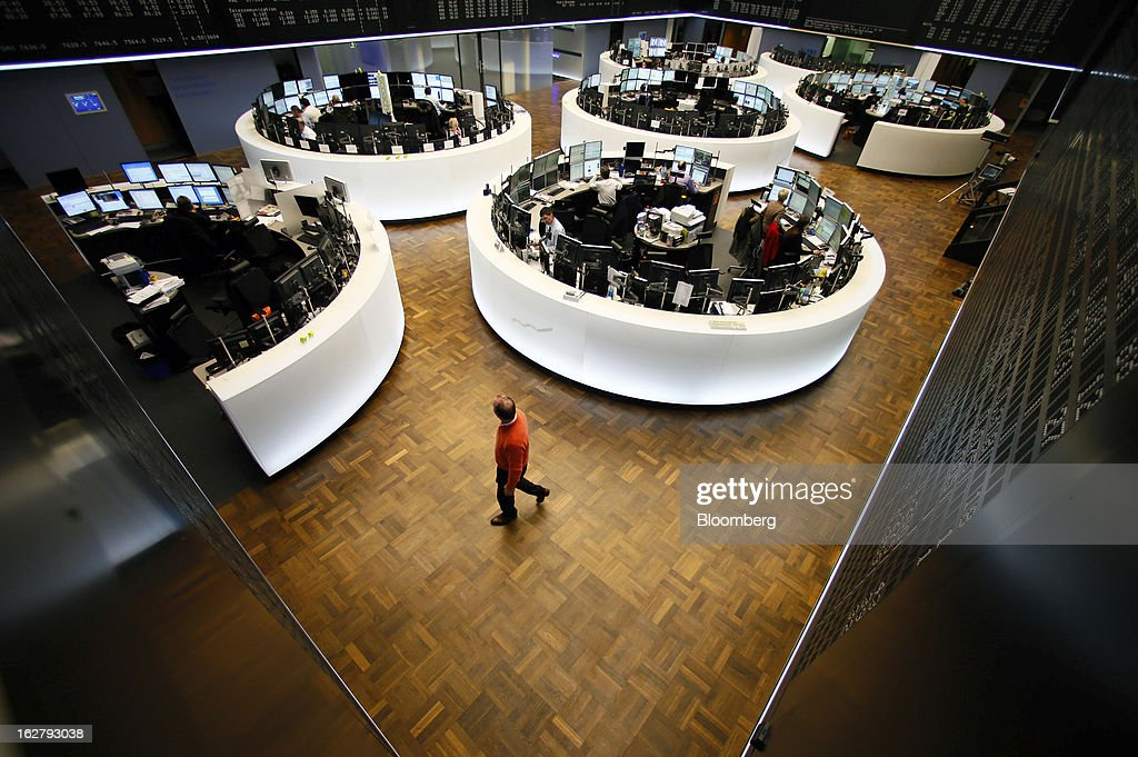 A financial trader walks across the trading floor inside the Frankfurt Stock Exchange in Frankfurt, Germany, on Tuesday, Feb. 27, 2013. Stocks rose, the euro strengthened from a seven-week low and Italian 10-year bonds gained after the country sold 6.5 billion euros ($8.5 billion) of debt amid political turmoil. Photographer: Ralph Orlowski/Bloomberg via Getty Images
