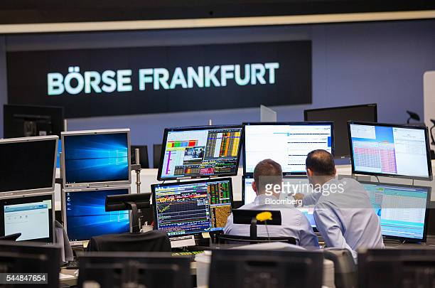 Financial traders monitor data on computer screens inside the Frankfurt Stock Exchange in Frankfurt Germany on Monday July 4 2016 London Stock...