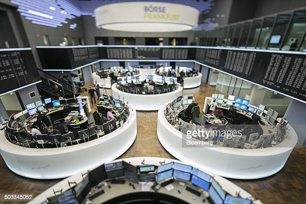 Financial traders monitor data on the floor of the Frankfurt Stock Exchange in this photograph taken with a tiltshift lens in Frankfurt Germany on...