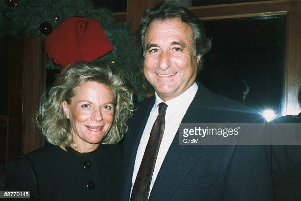 ACCESS*** Financier Bernard Madoff and his wife Ruth Madoff attend a holiday party during December 1989 in New York City